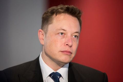 Elon Musk, billionaire, co-founder and chief executive officer of Tesla Motors Inc., during an interview inside the Tesla store at Westfield Stratford City retail complex in London, on Oct. 24, 2013.